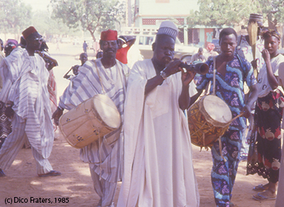 Music group with traditional instruments in street of Niamey