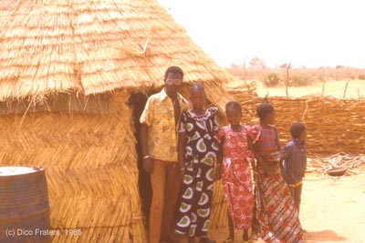 A family in front of their house at Sadore, Niger