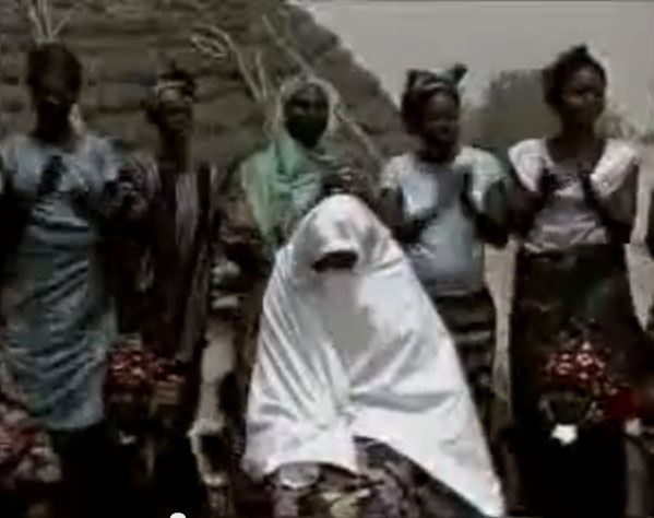 Half circel of women singing insults during Marcanda ritual